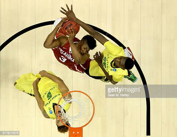 Chris Boucher of the Oregon Ducks blocks the shot of Christian James of the Oklahoma Sooners in the second half in the NCAA Men's Basketball...