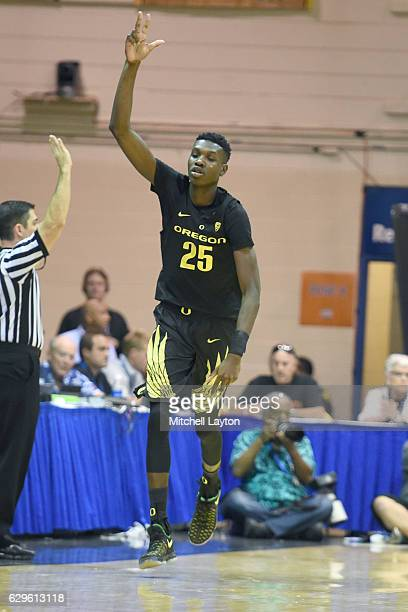 Chris Boucher of the Oregon Ducks celebrates a shot during the Maui Invitation college basketball tournament game against the Connecticut Huskies at...