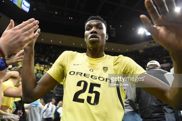 Chris Boucher of the Oregon Ducks celebrates with the students after they defeated the fifth ranked Arizona Wildcats 8558 at Matthew Knight Arena on...