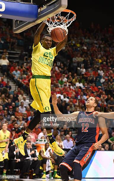 Chris Boucher of the Oregon Ducks dunks against Ryan Anderson of the Arizona Wildcats during a semifinal game of the Pac12 Basketball Tournament at...