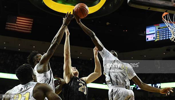 Chris Boucher of the Oregon Ducks grabs a rebound over of Luke Morrison of the Army Black Knights in the first half of the game at Matthew Knight...