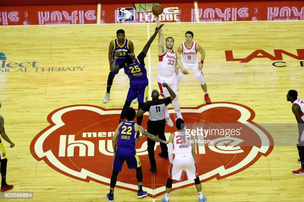 Chris Boucher of the Santa Cruz Warriors and Austin Nichols of the Memphis Hustle jump for tip off to start the game during an NBA GLeague game on...