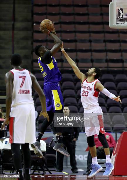 Chris Boucher of the Santa Cruz Warriors shoots the ball against Jeremy Morgan of the Memphis Hustle during an NBA GLeague game on March 10 2018 at...