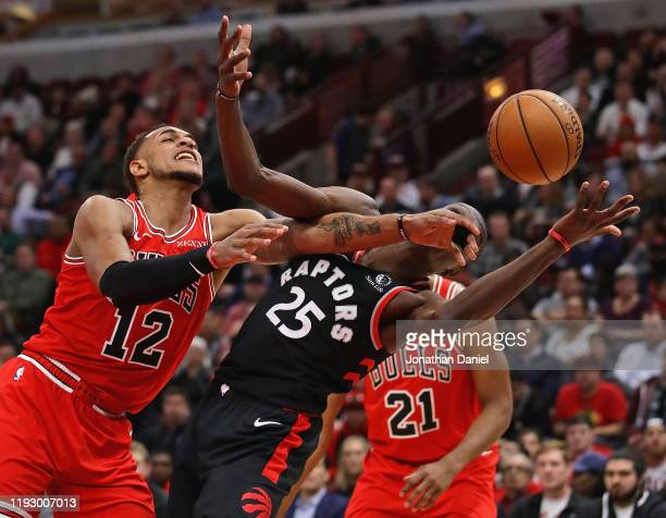 Chris Boucher of the Toronto Raptors and Daniel Gafford of the Chicago Bulls battle for the ball at the United Center on December 09 2019 in Chicago...