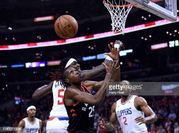 Chris Boucher of the Toronto Raptors and Montrezl Harrell of the LA Clippers go for a rebound during a 9888 Clippers win at Staples Center on...