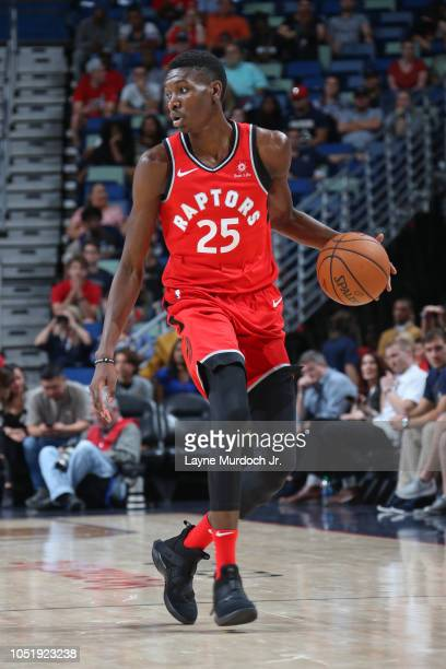 Chris Boucher of the Toronto Raptors dribbles the ball against the New Orleans Pelicans during a preseason game on October 11 2018 at Smoothie King...