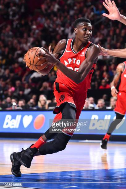 Chris Boucher of the Toronto Raptors dribbles the ball against the Brooklyn Nets during the preseason NBA game at the Bell Centre on October 10 2018...