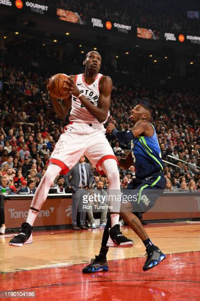 Chris Boucher of the Toronto Raptors drives to the basket against the Dallas Mavericks on December 22 2019 at the Scotiabank Arena in Toronto Ontario...