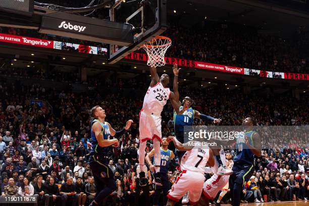 Chris Boucher of the Toronto Raptors dunks the ball against the Dallas Mavericks on December 22 2019 at the Scotiabank Arena in Toronto Ontario...
