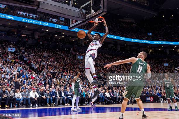 Chris Boucher of the Toronto Raptors dunks the ball against the Milwaukee Bucks on February 25 2020 at the Scotiabank Arena in Toronto Ontario Canada...