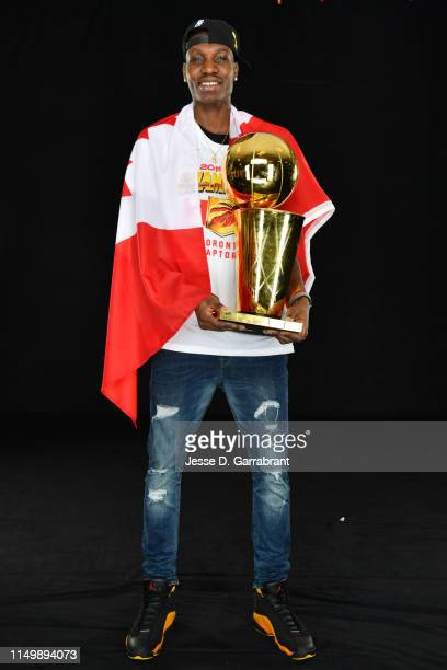 Chris Boucher of the Toronto Raptors poses for a portrait with the Larry O'Brien Trophy after winning Game Six of the 2019 NBA Finals against the...