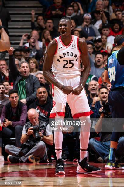 Chris Boucher of the Toronto Raptors reacts to a play during the game against the Dallas Mavericks on December 22 2019 at the Scotiabank Arena in...