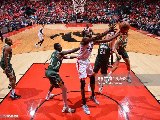 Chris Boucher of the Toronto Raptors rebounds the ball against the Milwaukee Bucks during Game Four of the Eastern Conference Finals of the 2019 NBA...