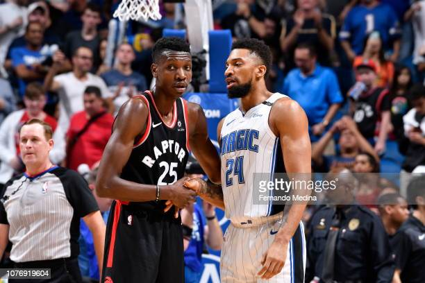 Chris Boucher of the Toronto Raptors shakes the hand of Khem Birch of the Orlando Magic after the game on December 28 2018 at Amway Center in Orlando...