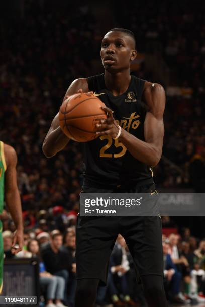 Chris Boucher of the Toronto Raptors shoots a free throw against the Boston Celtics on December 25 2019 at the Scotiabank Arena in Toronto Ontario...