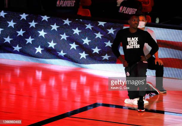 Chris Boucher of the Toronto Raptors takes a knee during the national anthem before the start of a game against the Brooklyn Nets in Game One of the...