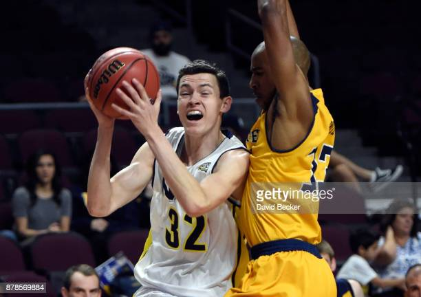 Chris Bowling of the Northern Arizona Lumberjacks drives against Brandon Smith of the UC Irvine Anteaters during the 2017 Continental Tire Las Vegas...