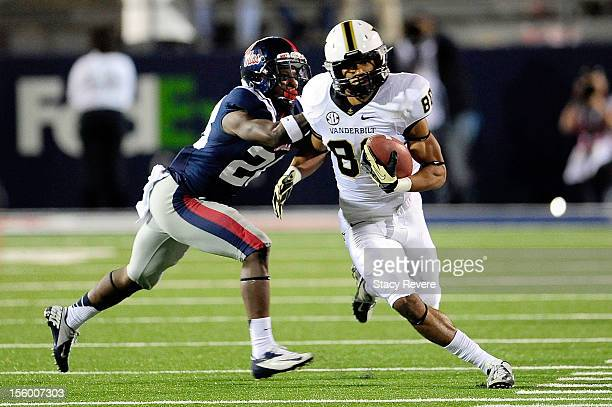 Chris Boyd of the Vanderbilt Commodores is pushed out of bounds by Mike Hilton of the Ole Miss Rebels during a game at VaughtHemingway Stadium on...