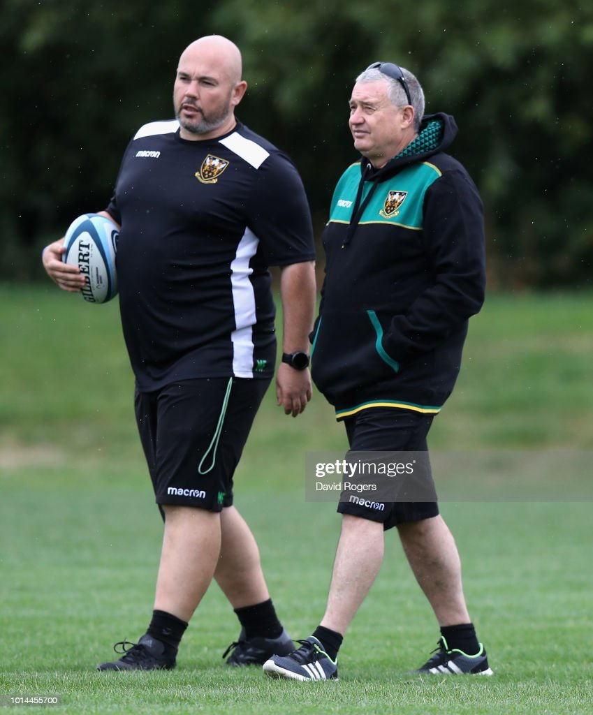 Chris Boyd, (R) the Northampton Saints director of rugby looks on with Matt Ferguson, the Northampton Saints assistant coach during the Northampton Saints training session held at Franklin's Gardens on August 10, 2018 in Northampton, England.