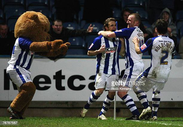 Chris Brandon of Huddersfield Town celebrates his goal with team mates during the FA Cup sponsored by E.ON Third Round match between Huddersfield...