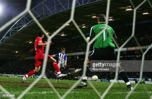 Chris Brandon of Huddersfield Town scores the winning goal during the FA Cup sponsored by EON Third Round match between Huddersfield Town and...