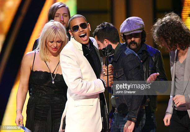 Chris Brown accepts the Male Artist of the Year Award from Courtney Love and the Killers