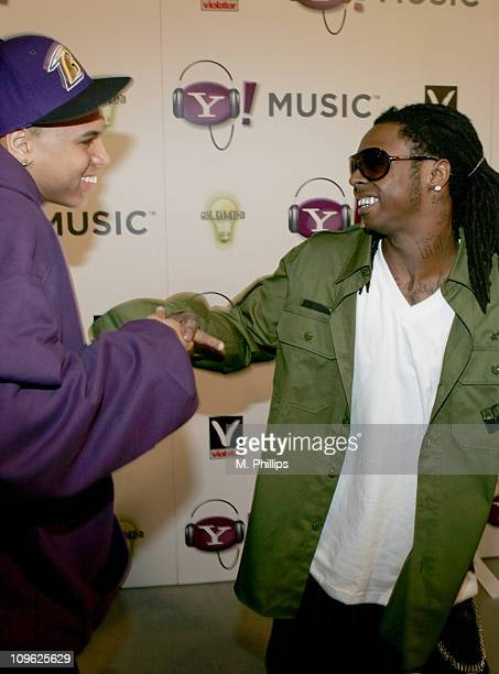 Chris Brown and Lil Wayne during Yahoo Music and Missy Elliot PostGrammy Event at Mood in Hollywood CA United States