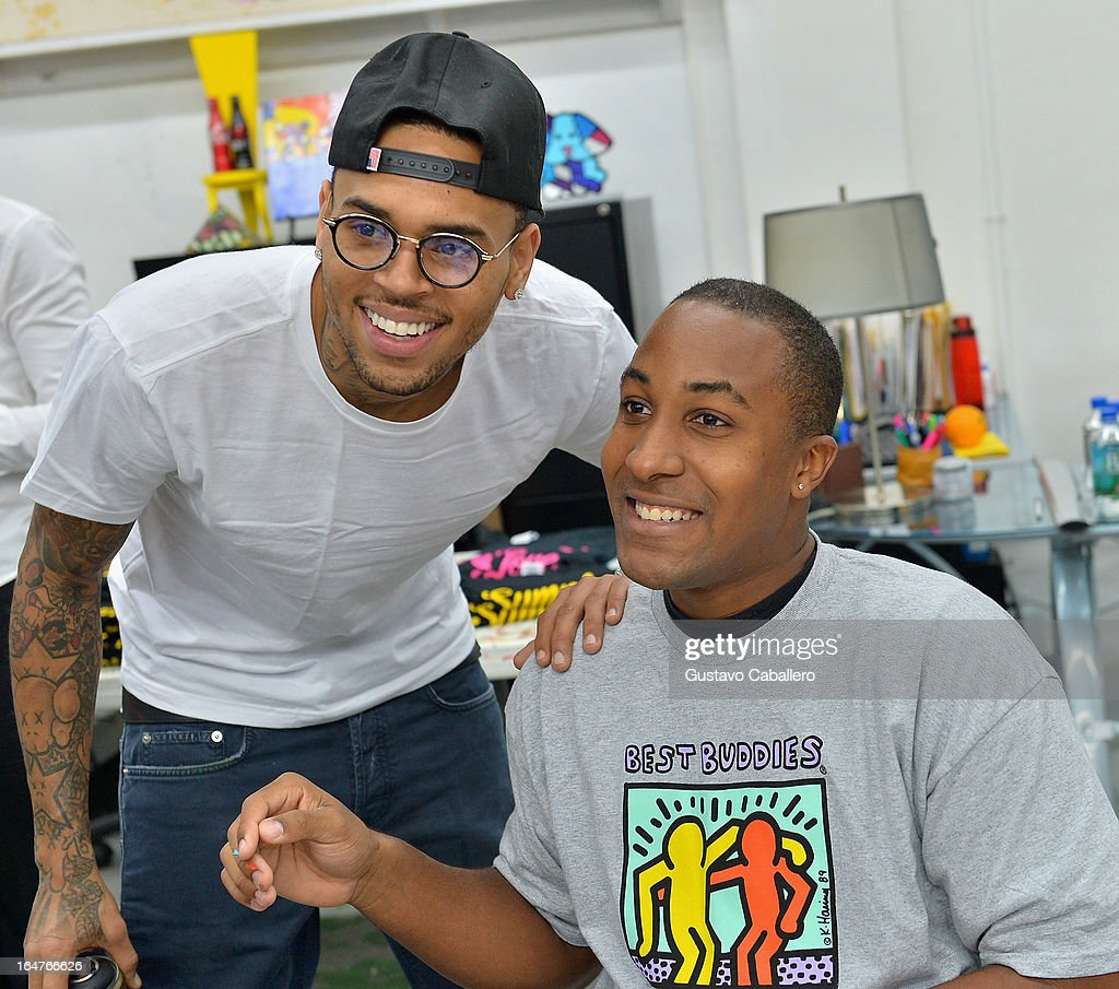 Chris Brown and Marcus Gray attend the Chris Brown joins forces with artist Romero Britto in support of Best Buddies International event on March 27, 2013 in Miami, Florida.