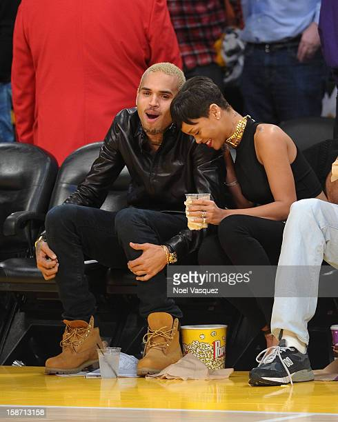 Chris Brown and Rihanna attend a basketball game between the New York Knicks and the Los Angeles Lakers at Staples Center on December 25 2012 in Los...