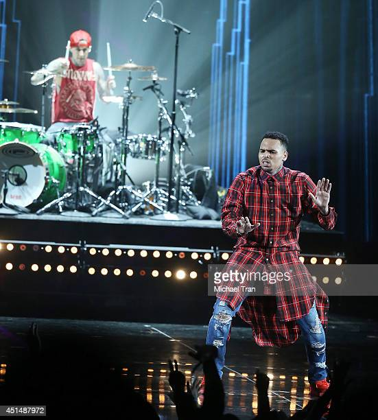 Chris Brown and Travis Barker perform onstage during the 'BET AWARDS' 14 held at Nokia Theater LA LIVE on June 29 2014 in Los Angeles California