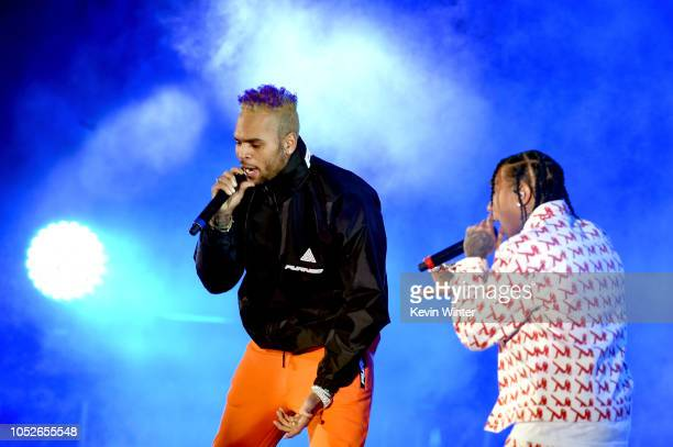 Chris Brown and Tyga performs onstage during 'We Can Survive A Radiocom Event' at The Hollywood Bowl on October 20 2018 in Los Angeles California