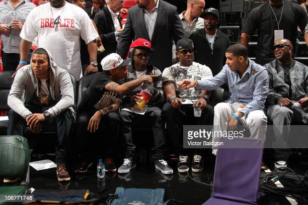 Chris Brown Bow Wow Lil Wayne a friend Drake and Birdman watch the Miami Heat play against the Boston Celtics on November 11 2010 at American...