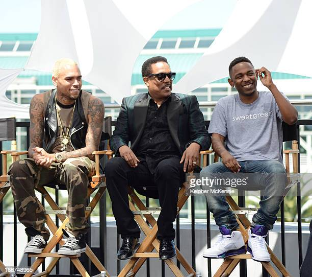 Chris Brown Charlie Wilson and Kendrick Lamar on stage at the 2013 BET Awards press conference at Icon Ultra Lounge on May 14 2013 in Los Angeles...
