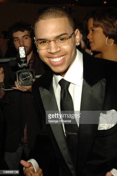 Chris Brown during 2006 Clive Davis PreGRAMMY Awards Party Red Carpet at Beverly Hilton in Beverly Hills California United States