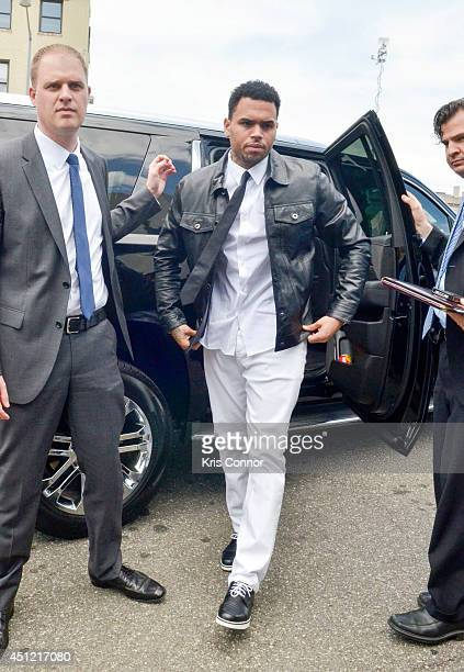Chris Brown enters the H Carl Moultrie I Court House of the District of Columbia where he is rejecting a plea deal for a October 28 2013 assault...