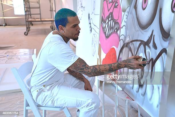 Chris Brown is seen at Chris Brown And KAI At Fine Art Auctions Miami's Urban Art Week on February 12 2015 in Miami Florida