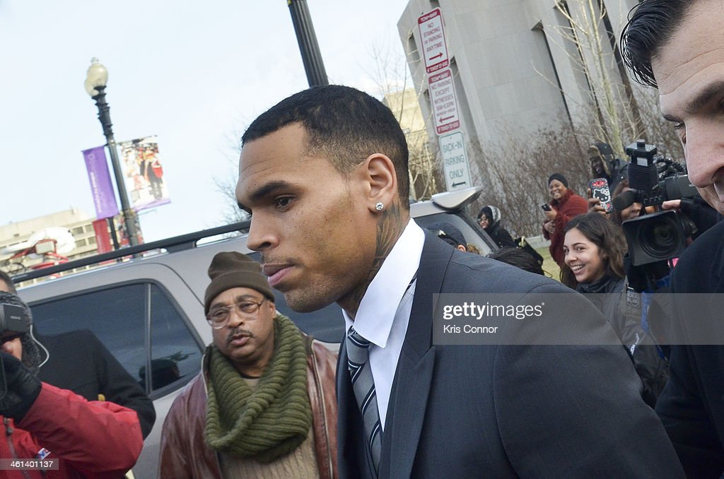 Chris Brown (C) leaves court where his attorneys rejected a plea deal that would have found him and his bodyguard guilty of simple assault on January 8, 2014 in Washington, DC. Brown faces a misdemeanor assault charge for allegedly punching a man in the face in October 2013.