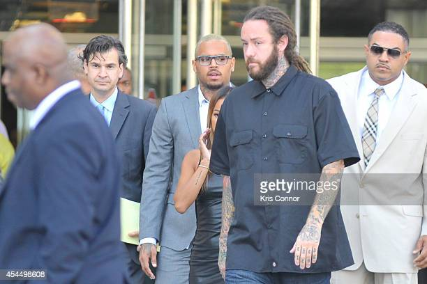Chris Brown leaves the H Carl Moultrie I Court House of the District of Columbia where he took a plea deal for an assault charge on September 2 2014...