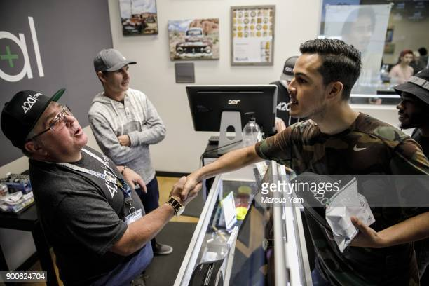 Chris Brown left an employee of 420 Central and Jason Ayala right thank each other for a smooth transaction at 420 Central in Santa Ana Calif on Jan...