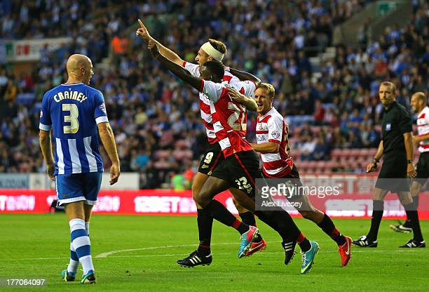 Chris Brown of Doncaster Rovers celebrates with Theo Robinson after scoring the second goal during the Sky Bet Championship match between Wigan...