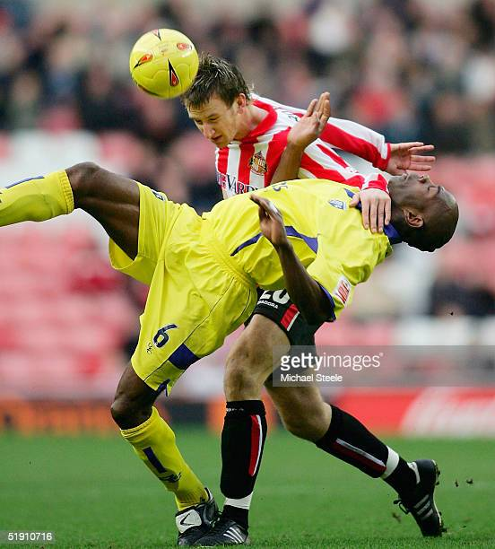 Chris Brown of Sunderland forces into Ian Cox of Gillingham during the Coca Cola Championship match between Sunderland and Gillingham at the Stadium...