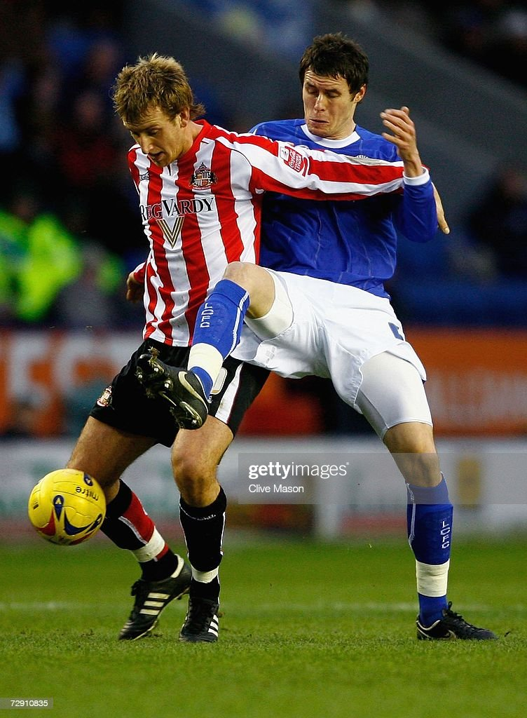 Chris Brown of Sunderland is challenged by Patrick McCarthy of Leicester City during the Coca Cola Championship match between Leicester City and Sunderland at the Walkers Stadium on January 1, 2007, in Leicester, England