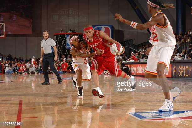 Chris Brown of the HTown handles the ball against Bow Wow of the Clutch City during the McDonald's NBA AllStar Celebrity Game at NBA Jam Session...