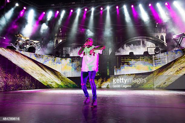 Chris Brown performs during the One Hell of a Night Tour at DTE Energy Center on August 16 2015 in Clarkston Michigan