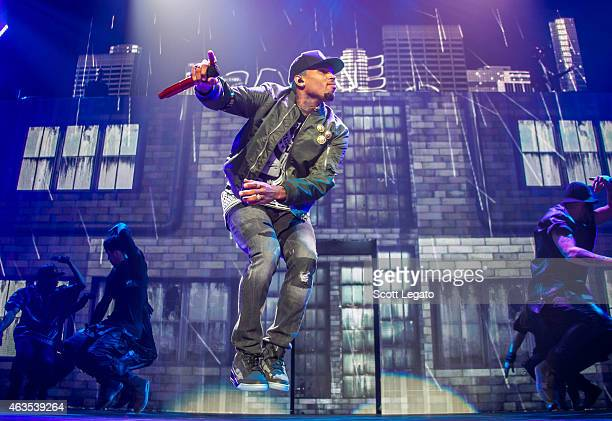 """Chris Brown performs in support of his """"Between The Sheets Tour"""" at Joe Louis Arena on February 15, 2015 in Detroit, Michigan."""