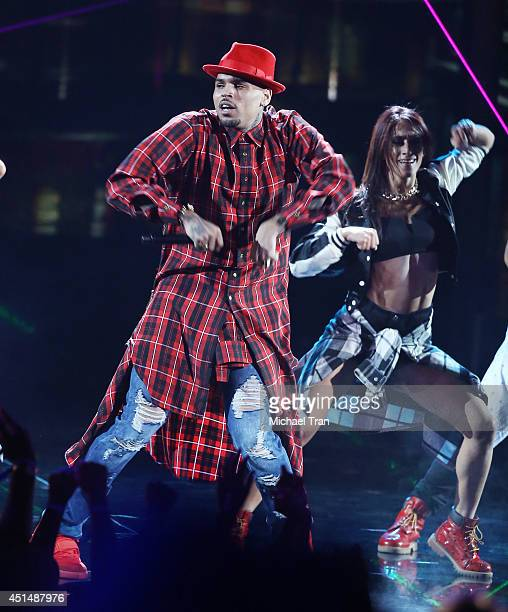 Chris Brown performs onstage during the 'BET AWARDS' 14 held at Nokia Theater LA LIVE on June 29 2014 in Los Angeles California