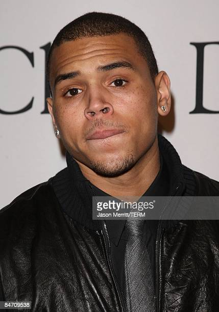 Chris Brown poses on the red carpet as she arrives at the 2009 PreGrammy Gala Salute to Industry Icons event in Beverly Hills on February 7 2009