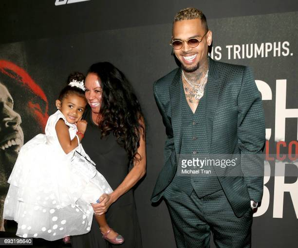 """Chris Brown with mom, Joyce Hawkins and his daughter, Royalty Brown attend the Los Angeles premiere of Fathom Events' """"Chris Brown: Welcome To My..."""
