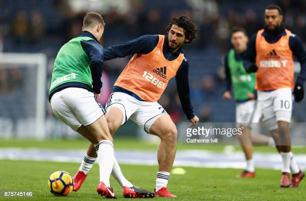 Chris Brunt and Ahmed ElSayed Hegazi of West Bromwich Albion warm up prior to the Premier League match between West Bromwich Albion and Chelsea at...