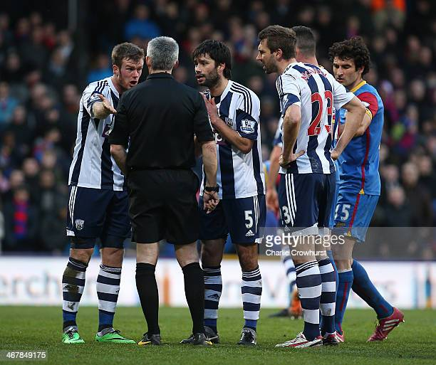 Chris Brunt Claudio Yacob and Gareth McAuley of West Brom appeal to referee Chris Foy after he awards a penalty to Palace during the Barclays Premier...